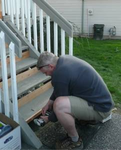 Front porch Tom working